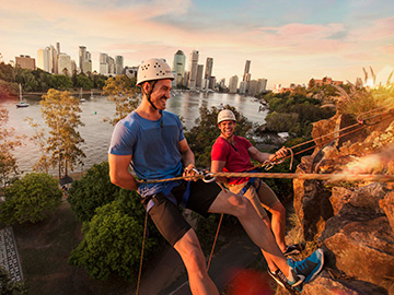 Two men rock climb at Kangaroo Point Cliffs