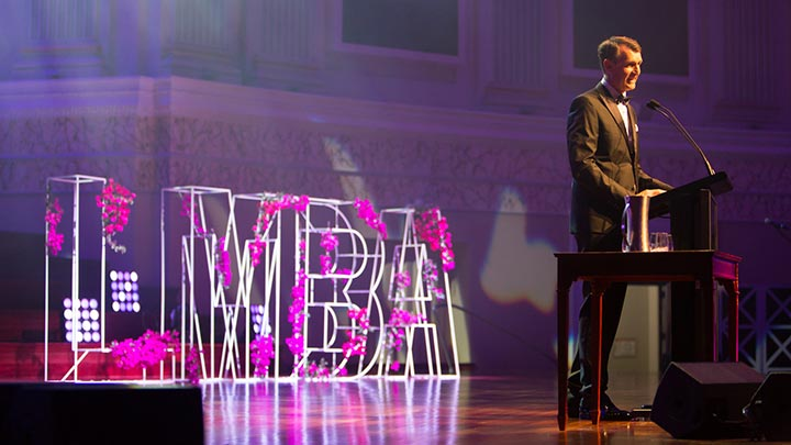 Lord Mayor Graham Quirk on stage at LMBA