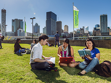 International Students studying by the Brisbane river