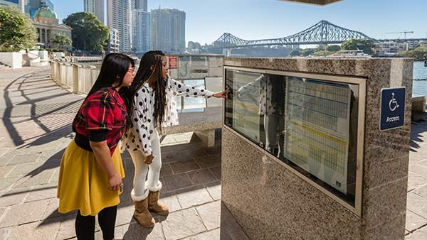 International Students checking out the Brisbane Ferry timetable
